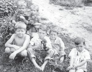 """Pictured are (back row) Billy Hatton, Larry Hatton, (front row) Coach Hillard Howard, Robert Hatton, Astor 'Red' Hatton and your old carpet man Charles Howard. """"Don't let this picture fool you,"""" says Whitesburg correspondent Oma Hatton, """"they are all senior citizens and grandfathers. Didn't have enough puppies for everyone. They just look young."""""""