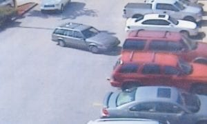Whitesburg police say the suspect in the photo at the top of this page has been seen arriving and leaving Walmart in the car pulling out of the parking spot in the photo above and the white van in the photo below.