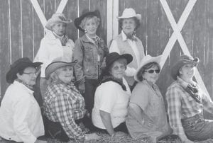 The Laureate Rho Sorority of Whitesburg met Sept. 5. The members, dressed as cowgirls, were photographed by Sue Banks in front of a Western themed backdrop. The sorority members then went to Hillbillies BBQ in downtown Whitesburg, where they were greeted by two of the owners, Charles and Brandee Hall. Pictured above are sorority officers and executive board members, President Ann Reynolds, Vice President Ellen Compton, Recording Secretary Jolinda Wright, Corresponding Secretary Cheryl Hall, Treasurer Janet Tucker, Extension Officer Sally Caudill, Advisor Irene Smith, Sponsor Norma Collins. Also attending the meeting were Sandy Banks, Ann Bradley, Penny Combs, Anna Ruth Estep, Jo Champion, Mahala Frazier, Pearl Goode, Liz Lee, Shannon Mullins, Ann Hall, Vernell Mullins, Patty Nantz, Brenda Quillen, and Earlene Williams.