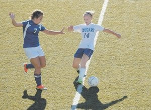 At right, Letcher Central senior defender Meg Raleigh (14) blocked a North Laurel player's attempt at the ball during the Cougars' 2-0 win on Saturday. The win improved LCC's season mark to 7-2.