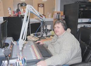 WTCW/WXKQ station manager Kevin Day of Cowan got his start in radio by working as a volunteer programmer at non-commercial WMMT-FM in Whitesburg. Day began working for the commercial stations in 1988 and became general manager in 2002. (Photo by Sally Barto)