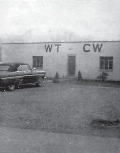 In photo at left, WTCW-AM's original home at Mayking is seen a year after the station went on the air in 1953. Below, WTCW and WXKQ-FM are located near the top of Thornton Hill.