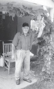 Landon Sexton of Colson, shows off his bean vines in this picture from 2009.