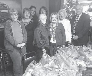 At their December meeting, members of the Letcher County Retired Teachers Association (LCTRA) bagged school supplies to be delivered to elementary schools in Letcher County. The supplies were made possible by a matching grant from AARP, the Kentucky Retired Teachers Association and LCTRA, along with a gift certificate from Walmart. Pictured are (left to right) Joyce Whitaker, Marcia Caudill, Bonita Pigman, Juanita Banks, Margaret Whitaker, Mahala Frazier, Gladys Campbell and Elwood Cornett.