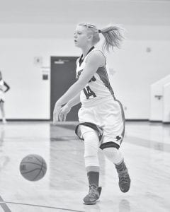 Senior guard Kelli Quillen was photographed in action last week for the Letcher County Central Lady Cougars, who are on a five-game winning streak. (Photo by Brandon Meyer/B. Meyer Images)