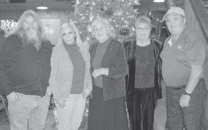 """Whitesburg correspondent Oma Hatton says, """"On the left are Larry Hatton and wife Linda and on the right are Billy Hatton and wife Sandra and I'll let you guess who the old lady in the middle is. That was at the Howard Christmas party at Cowan Community Center. It was a great party, noisy but nice. We all talk a lot."""""""