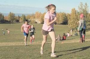 Central and Mirror Lake Middle School cross-country runners, wearing pink for breast cancer awareness, climbed the final hill of a cross-country race at Kincaid Park in Anchorage, Alaska in October. According to the Centers for Disease Control and Prevention, only 1 in 4 U.S. kids aged 12 to 15 meet the recommendations of an hour or more of moderate to vigorous activity every day. The CDC released partial results last week from a fitness survey, which involved kids aged 3 to 15. (AP Photo)