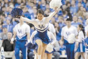Sports journalism around University of Kentucky athletics has become nothing but a pep rally, observes longtime columnist Bob Watkins, with the team's cheerleading squad, shown here in action at the UK-Tennessee game Saturday, being about the only thing missing. (AP photo)