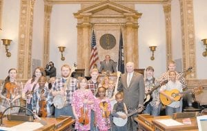 The Cowan Creek Youth String Band was honored on the floor of the Kentucky State Senate by Senator Johnny Ray Turner, D-Prestonsburg. Members of the band attend the Cowan Creek Mountain Music School and Passing the Pick and Bow after-school program. The band also was honored on the floor of the House of Representatives by Rep. Leslie Combs, D-Pikeville. Photo by LRC Public Information Office.