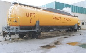Union Pacific is using this natural gas tender car in New Hampshire to provide fuel for an experimental natural gas locomotive. (AP Photo)