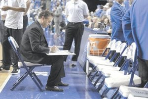 PLANNING THE SECOND HALF — UK Coach John Calipari worked on a plan to start the second half of his team's victory over Georgia at Rupp Arena on January 25. Calipari may need to start work on a plan to make college basketball as popular elsewhere in the U.S. as it is in Kentucky and other basketball crazy states. (AP Photo)