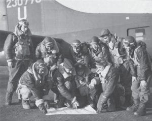 """LETCHER COUNTY WAR HERO — Staff Sgt. Thomas E. Morton of Carbon Glow (standing, fourth from left) was photographed with fellow crew members of the 388th Bomb Group beside the Boeing B-17 Flying Fortress """"Old 66."""" The plane's pilot 1st Lt. John C. Mouat is pictured in this January 1944 photo kneeling at far right."""