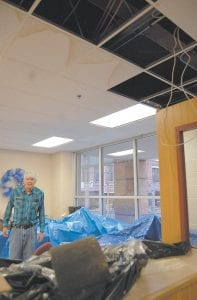 Letcher County Clerk Winston Meade was overwhelmed Monday morning as he stood in part of the clerk's office that was damaged by flooding over the weekend.
