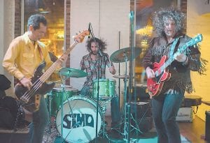 SIMO performed an impressive set at Summit City in Whitesburg Saturday night. Band members are bassist Frank Swart, drummer Adam Abrashoff and guitarist JD Simo. (Photo by Jonathan Newsome)