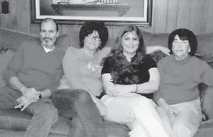 Seated on a couch with Jenetta Howard are her children, Keith Howard, Doretha Bentley and Edwina Adams.