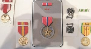 The Bronze Star Medal earned by Letcher County Sheriff Danny Webb can be seen in the center of this photo showing other medals and awards he earned while fighting in Vietnam. The medal arrived last week as a replacement for one lost in the mail shortly after Webb earned his release from the Army.