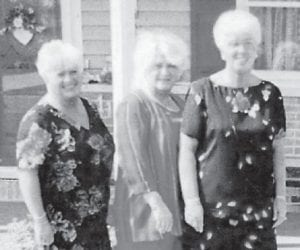 Joella Taylor Sturgill (right) is pictured with her sisters, Madonna (center) and Sharon, at a mother and daughter banquet held at her church. Since she doesn't have a daughter, her sisters always attend the banquet with her.