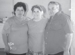 Brenda and Dexton Howard pose with Oma Hatton at a Howard family reunion held several years ago. Both of the Howards are having health problems now.