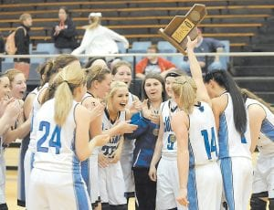 FREQUENT FLYERS — Members of the Letcher County Central Lady Cougars celebrated after holding off a determined Knott County Central team to capture their third straight district title. (Photo by Chris Anderson)