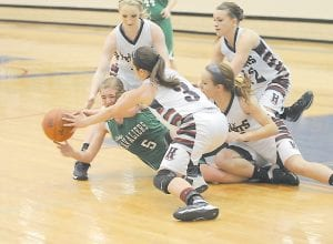 JENKINS GIRLS FALL — Whitney Creech (5) battled hard against four Knott County Central defenders during the Lady Cavs' 72-52 loss to the Lady Patriots in the 53rd District Tournament last week in Hindman. (Photo by Chris Anderson)