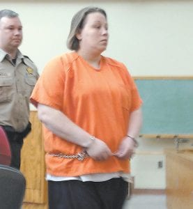 """ADMITS TO HUSBAND'S MURDER — Stephanie Fleming, 32, was escorted out of the Letcher Circuit Courtroom Monday by Letcher County Deputy Sheriff Jason Boggs. Fleming, 32, pleaded guilty to helping her lover, James Maggard, plan and carry out the brutal slaying of Dradrick """"Drad"""" Fleming , her husband and father of her two young children."""