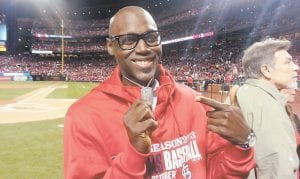 Soul singer and military veteran Brian Owens, who will perform in Whitesburg Saturday, showed his dog tags before singing the National Anthem at Busch Stadium in St. Louis last October for Game Six of the National League Championship Series. (Photo by Joe Holleman, courtesy St. Louis Post-Dispatch)