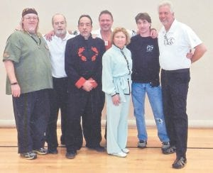 Ng Family Martial Arts masters attended the Battle of the Bluegrass Martial Arts Tournament to honor their teacher and great grandmaster, Dr. John Ng. Pictured are (left to right) Master Rick Pickens, Grandmaster Tom Pardue, Master Bruce Linville, Grandmaster Tim Pickens, Master Nancy Compton, Master Frank Sexton and Master Donnie Averitt. The group will also attend Somer-Slam Open Martial Arts Tournament on March 22 in Somerset.