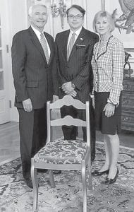 At center, Dr. David A. Narramore of Whitesburg, is pictured with Gov. Steve Beshear and First Lady Jane Beshear at the Governor's Mansion in Frankfort. Narramore is the donor of a handcrafted chair to the Mansion, made by Berea College students as part of the County Seats Legacy Project.