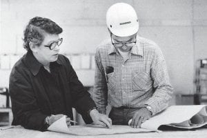 In this 1979 photo, Pat Gish looked over plans for one of 170 new homes the Eastern Kentucky Housing Development Corporation had built under her guidance in the past six years for low-income families in Leslie, Knott, Letcher and Perry counties. The homes, most of them with three-bedroom structures designed by architects affiliated with Yale University, could be purchased for about $23,000. EKHDC, which had also repaired 3,500 homes by 1979, became the model for 23 other similar home-repair projects across the nation. After funding for the $2 million-per-year program ended during the Reagan administration, E.K.H.D.C. folded into what is now HOMES Inc.