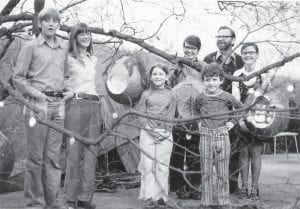 "Pat Gish posed for this family Christmas photo in the early 1970s with husband Tom and children (from left) Ben, Sarah, Kitty, Ray and Ann. Mrs. Gish, who died April 13, was ""a mother who would have much preferred to be at home, cooking dinner for her children and then reading aloud to them or watching television with them,"" writes Mountain Eagle contributing editor Tom Bethell. ""Instead she was a mother at work."" Funeral services for Mrs. Gish, who became publisher of the Eagle after the death of her husband in 2008, will be held at 1 p.m. Thursday at Graham Memorial Presbyterian Church in Whitesburg."