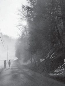 Robbie, Ernie, Carla and Raven Ison volunteered to turn traffic around for three hours. Fire trucks were a half mile down the road from the roadblock. The photograph was taken in front of Raven and Ernie Ison's house on Sunday.