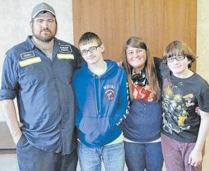 Rene Cornette posed for this photo with her husband and sons. (Photo courtesy Harlan Daily Enterprise)