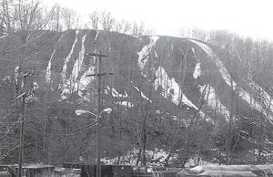 Slate dumps like this one seen in Pennsylvania were once visible throughout Letcher County and other coal mining counties in southeastern Kentucky. (Photo courtesy www.coalcampusa.com)