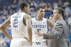 Kentucky head coach John Calipari, right, instructed Aaron Harrison (2) and Andrew Harrison (5) during an NCAA college basketball game in Lexington earlier this year. The twin freshman guards will return for a second season to a stocked Wildcats squad coming off an NCAA championship appearance. (AP Photo)