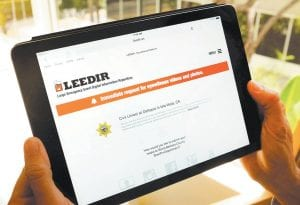 This photo shows a tablet computer displaying a web site for LEEDIR or the Large Emergency Event Digital Information Repository that aims to make use of a document-everything culture evident on Instagram, Facebook and other social media to benefit law enforcement nationwide. (AP Photo)