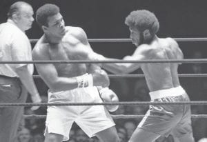 Jimmy Ellis, right, lost to fellow Kentuckian Muhammad Ali in Houston in 1971. Ellis died Tuesday at age 74. (AP photo)