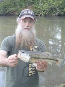 """Fishing columnist Greg """"Gabby"""" Caudill poses with one of the nice largemouth bass he caught while visiting in Georgia last week."""