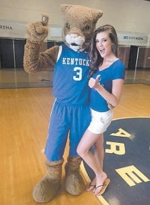 Little Cowan resident Destin Kincer, reigning Miss Kentucky USA 2014 and a University of Kentucky student, poses with the UK mascot May 5 at Rupp Arena. Kincer was being filmed by an NBC crew for a feature to air before the Miss USA pageant June 8.