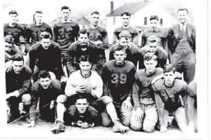 Pictured is the Fleming football team, Ralph Jones, Henry Ed Wright, Homer Khul, Don Richardson, Holland Hall, Hoover Dawahare, Coach Walter Enlow, unknown, Ed McKinney, Nathan Hale, Joe Pass, Dicky Bentley, Jack Burkich, Richie Davidson, Hargis Sisk (with football), Elmer Meade, Dan Potter, Clifford Potter, and Elbert Richardson (QB, lying on ground). (Picture from the Fleming-Neon Alumni Facebook site, Wallace Kincer.)