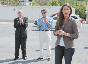"""PLEDGES SUPPORT FOR COAL — Kentucky Secretary of State Alison Lundergan Grimes drew applause from former Kentucky Gov. Paul Patton of Pikeville and current House of Representatives Speaker Greg Stumbo of Prestonsburg when she told an audience in Whitesburg last week that she supports eastern Kentucky's coal miners and will fight against any new and """"overburdensome"""" regulations that threaten more mining jobs. Grimes is being supported by fellow Democratic Party members Patton and Stumbo during her effort to unseat U.S. Senator Mitch McConnell."""