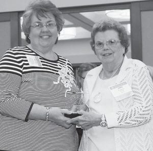 Rachel Breeding (left), Whitesburg ARH auxiliary coordinator, accepts the HANDS award from Ann Watkins, chair of the Kentucky Hospital Association Committee on Volunteer Services. Twenty-five auxiliary members volunteer at WARH.