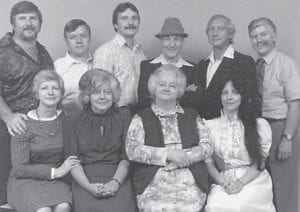 """Pictured is the family of the late Russell and Burnie Howard, (back row, left to right) Tom, Roger, Allen, Russell Howard, Jamie, Cecil, (front row) Imogene Adkins, Wanda Gay, Burnie Howard and Sharon. """"All the people from Marlowe will remember them,"""" said Whitesburg correspondent Oma Hatton."""