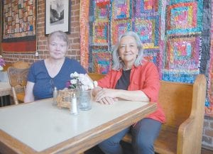 SAYING GOOD-BYE AFTER 29 YEARS — Courthouse Café owners Laura Schuster (left) and Josephine Richardson were photographed in the restaurant Tuesday after talking about their years of operating the Whitesburg restaurant, which will close for business on Friday. The restaurant, located at the corner of Main Street and North Webb Street, shares space with Richardson's gift shop, The Cozy Corner, which will remain open. (Photo by Sally Barto)