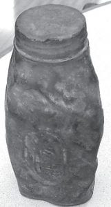 Note the dents in this old miner's flask for extra carbide. The item is now owned by Stella Elam of Blackey.