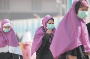 Muslim pilgrims wore surgical masks to help prevent infection from a respiratory virus known as the Middle East respiratory syndrome (MERS) in the holy city of Mecca, Saudi Arabia, earlier this month. (AP Photo)