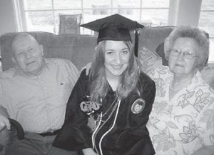 GRADUATE — Danielle Warrick was graduated with a bachelor of science degree in social work from Northern Kentucky University on May 10. She is a 2010 graduate of Letcher County Central High School. Pictured with her are her grandparents, Joe and Doris Bentley of Millstone. Her brother, Dr. Stephen Warrick, and her mother, Mary Quillen, also attended her graduation.