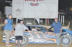 Oscar McCown, driver of the #11 pictured in victory lane with his crew at Mountain Motor.