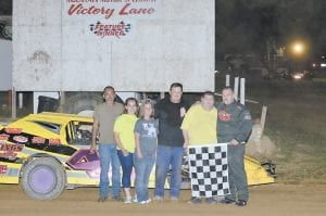 Kevin Harkins, who won the modified feature, is pictured with his crew.
