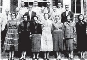 FLEMING-NEON HIGH FACULTY — Front row (left to right) Redda Reasor (high school and grades physical education), Mrs. P.M. Armstrong (secretary to the principal), Mrs. Joan Adkins (general business and history), Mrs. Uarda Creech (civics and soc.), Margaret Holbrook (home economics), Mrs. Ed Miracle (typing), Mrs. Helen Richardson (science and general math), second row, T. Dick Craft (algebra and geometry), Ira Frazier (English), Arthur Adams (librarian and English), Bronston Clay (English and law), Jerry Arrington (band and chorus), Jason Holbrook (principal), third row, Jack Hall (general math, health and assistant coach), David Hurst (English, journalism and head football coach), Ed Miracle (history and geography), P.M. Armstrong (biology, general math and head basketball coach).