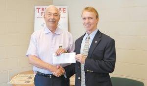 State Treasurer Todd Hollenbach presents check to Whitesburg Mayor James W. Craft. (Eagle photo)